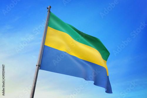 Fotografie, Obraz  Gabon flag waving on the blue sky 3D illustration