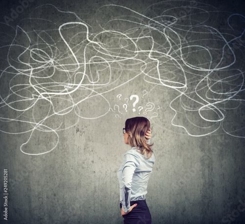 Confused business woman solving a problem Wallpaper Mural