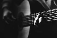 Close Up On Man Playin A Guitar, Black And White