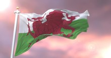Flag Of Wales Waving At Wind In Slow At Sunset Loop