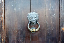 Bronze Door Knocker On The Old...