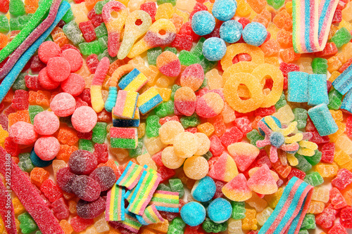 Assorted variety of sour candies includes extreme sour soft fruit chews, keys, tart candy belts and straws Fototapet