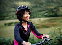 Cheerful Female Cyclist Enjoyi...