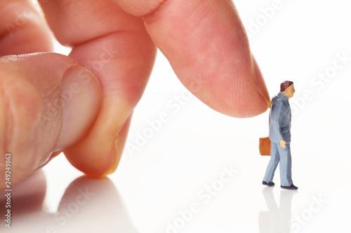 Fotografía  指で押されるビジネスマン