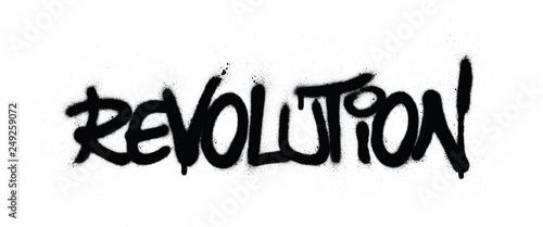 Fotografía graffiti revolution word sprayed in black over white