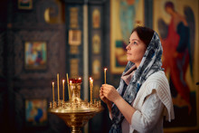 Orthodox Woman Praying In Fron...