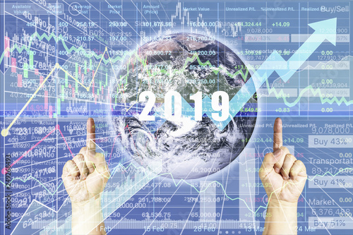 Fotografie, Obraz  Global Business and Economic vision in 2019 with Stock index presentation and victory hands with data number chart and graph background