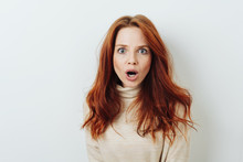 Shocked Young Woman With Her Mouth Agape