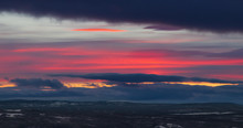 Panorama Of A Sunset In Idre, Sweden With A Pink Circular Cloud In The Vibrant Sky, Photographed In Winter.