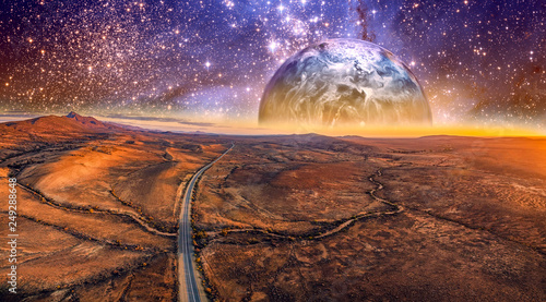Printed kitchen splashbacks Eggplant Alien planet rising over desert landscape with vivid starry sky and highway. Elements of this image are furnished by NASA