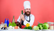 vegetable salad. Bearded man cook in kitchen, culinary. Healthy food cooking. Dieting and organic food, vitamin. Vegetarian. Mature chef with beard. Chef man in hat. Secret taste recipe