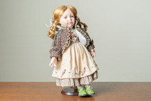 Porcelain Doll In An Old Dress