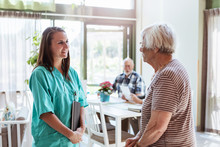 Nurse Talking With Senior Woma...