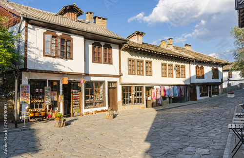 Old houses with souvenir shops at the Tsar Kaloyan Street in town of Tryavna #249301093