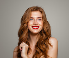 Happy Redhead Woman Smiling. Excited Red Head Girl With Curly Hairstyle. Ginger Hair, Cute Smile, Red Lips Makeup. Natural Authentic Beauty