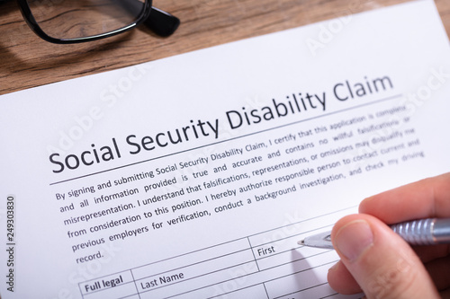Photo  Person Filling Social Security Disability Claim Form