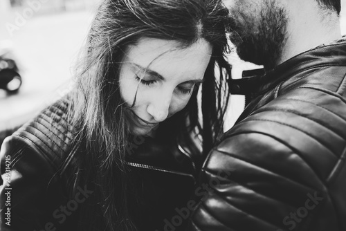 Black and white photo of woman leaning on the shoulders of a friend looking for comfort before a sentimental problem, divorce concept Wallpaper Mural