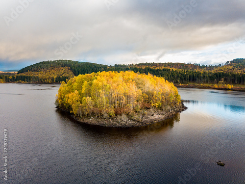 Fotografie, Obraz  Aerial view of lonely Island in Loch Garry in the scottish Highlands, Scotland