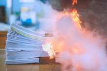 Double Exposure, Stacks Of Paper Files, Man Teaches How To Use Fire Extinguisher To Extinguish Fire.