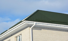 Brick House With Green Metal R...