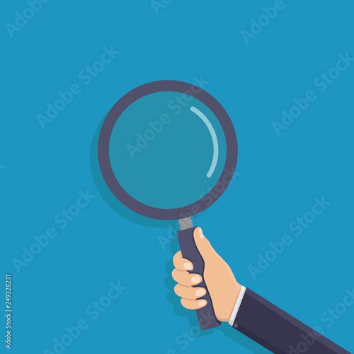 Slika na platnu Business hand holding a magnifying glass, flat design vector illustration