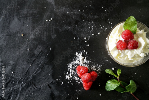 Fototapeta Top view of delicious summer dessert on slate with text space obraz