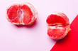 Leinwanddruck Bild - wo grapefruit, vagina symbol on a coral background