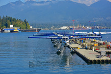 Seaplanes Parked At Dock On Co...