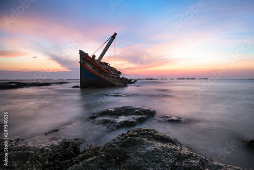 Fotobehang Schipbreuk Shipwreck or wrecked boat on beach