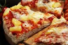 Delicious Pizza With Pineapple, Ham Slice, Bacon Slice, Mozzarella Cheese, Pizza Sauce On Rustic Background For Fast Food And Ready To Eat Concept