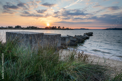 World War II tank defence blocks at Studland Bay at sunset - Buy