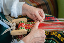Woman Working At The Weaving Loom. Traditional Ethnic Craft Of Baltic. - Image