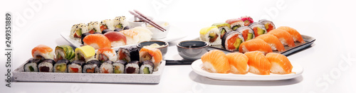 close up of sashimi sushi set with chopsticks and soy - sushi roll with salmon and sushi roll with smoked eel