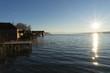 canvas print picture - Bootshäuser am Starnberger See im Winter