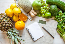 Flat Lay Composition With Scales, Healthy Vegetables And Fruit On Wooden Background. Weight Loss Diet