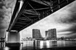A panorama of Belgrade seen from the banks of the Sava River. Old bridge and waterfront of Belgrade. Black white photo