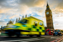 An Ambulance Drives Over The Westminister Bridge. In The Background The Big Ben.