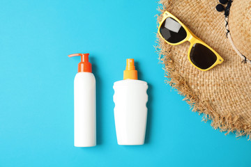 Flat lay composition with sun protection products on color background