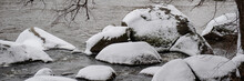 Stones In The River Covered With Snow.