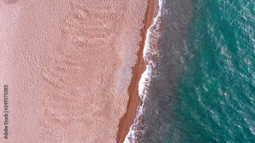 Valokuva  top aerial view of beautiful sandy beach and transparent turquoise sea
