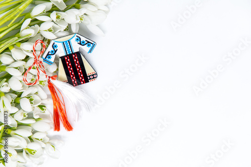 Fotografía  snow drops and pendant known as martisor on white with copy space, balkanic symb