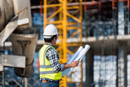 Engineering Consulting people on construction site holding