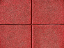 Four Red Squares On A Concrete...