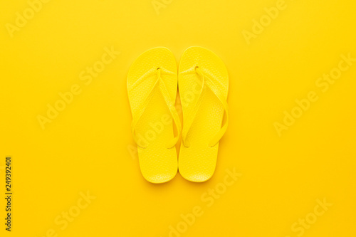 c7e8050cd92e beach flip-flops on the yellow background. summer concept - Buy this ...
