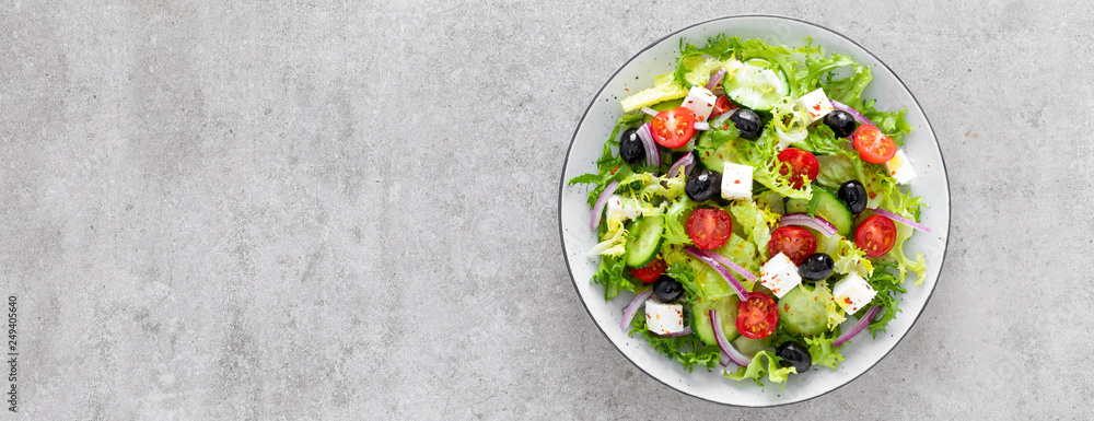 Fototapety, obrazy: Vegetable salad with fresh cucumber, tomato, olive, onion, lettuce and feta cheese. Healthy food. Top view. Banner.