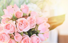 Pink Rose Flower / Soft And Light Pink Roses Blooming Spring Bouquet On Table Blur Background