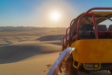 Sand Boarding ,Dune Buggy Parked In The Desert During Sunset At Huacachina Oasis In Ica, Peru.