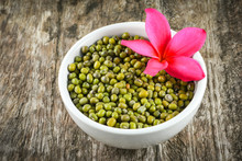 Mung Beans Or Green Beans Seed Cereal Whole Grains In White Bowl With Frangipani Flower Plumeria