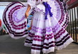 Leinwanddruck Bild Pretty purple Mexican dress