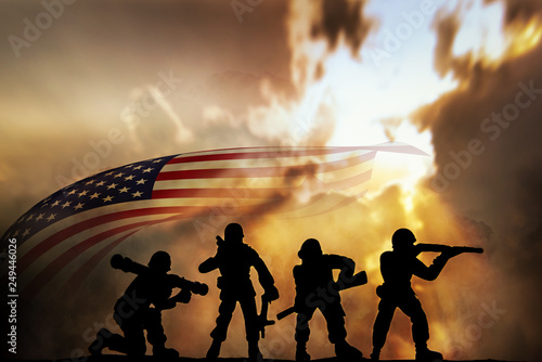 Tablou Canvas Silhouette of infantry on sky background. Veterans Day Concept